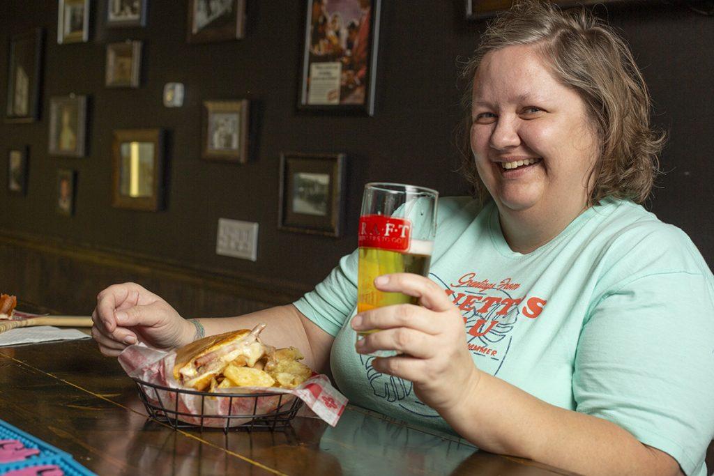 CGTG Gallery - Girl enjoying Cuban Sandwich and Craft Beer - 941-822-8131