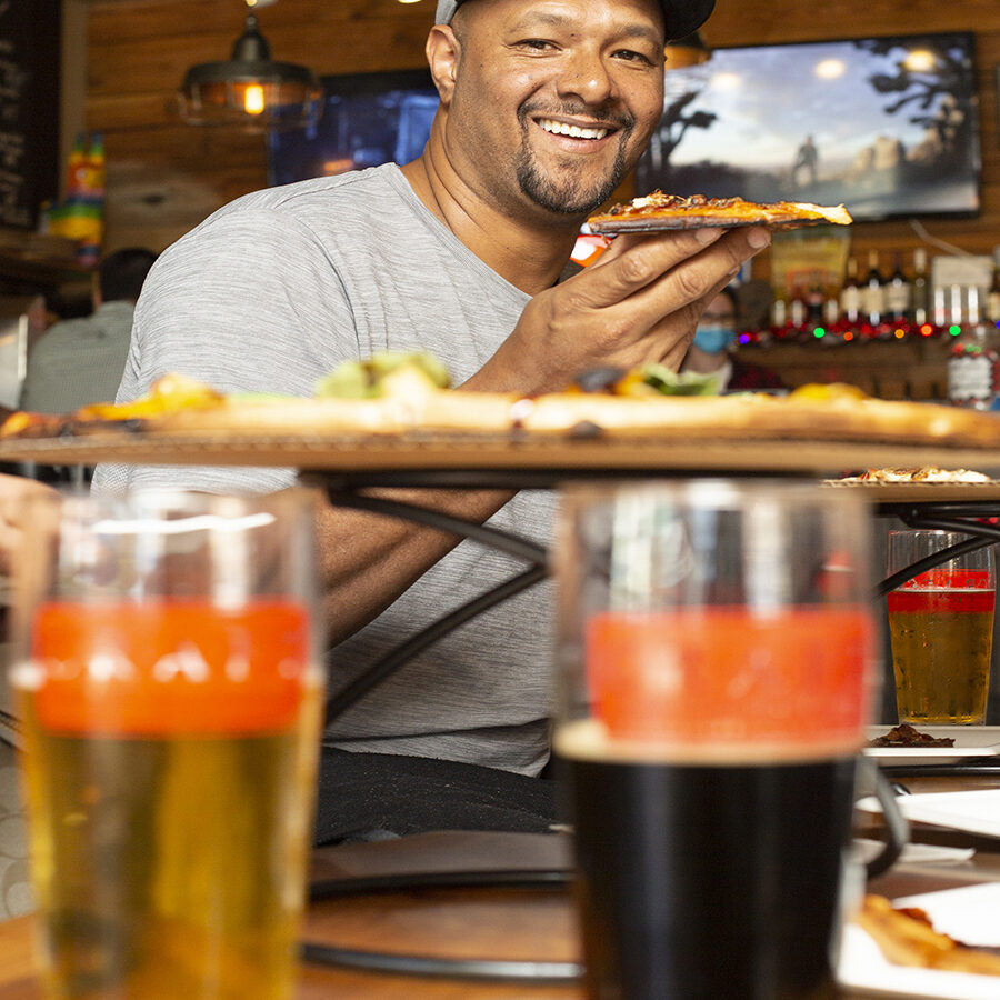 CGTG ABOUT - Man Enjoying Pizza and Craft Beer - 941-822-8131